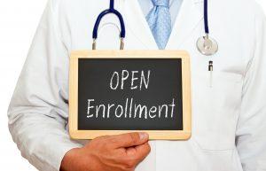 Open enrollment doctor holding sign